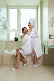 Young couple in bathrobe in hotel bathroom Stock Photo
