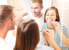 Young couple in the bathroom brushing teeth Royalty Free Stock Images