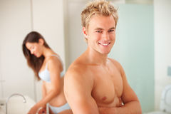 Young couple in the bathroom: Focus on man Stock Image