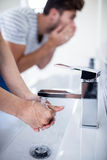 Young couple in bathroom Stock Images