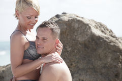 Young couple at the beach Stock Image