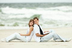 Young couple on beach royalty free stock images