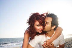 Young Couple at the Beach Stock Images