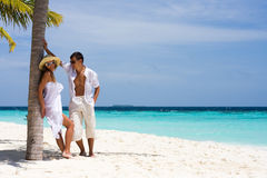 Young couple on a beach Royalty Free Stock Images