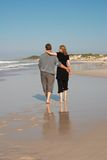 Young couple on the beach. Young married couple walking on the beach during their vacation in South Africa stock photo