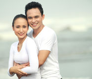 Young couple at the beach Royalty Free Stock Photo