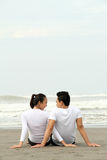 Young couple at the beach Royalty Free Stock Image