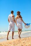 Young couple on the beach Stock Photos