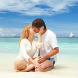 Young couple on the beach Stock Photo