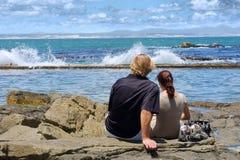 Young couple on beach Stock Photos