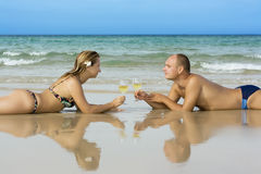 Young couple on the beach Stock Photos