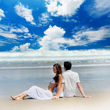 Young couple on a beach Royalty Free Stock Image
