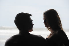 Young couple on a beach Royalty Free Stock Photos