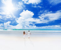 Young couple on a beach Stock Photos