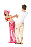 Young couple in beach clothes stand holding hands Royalty Free Stock Photos