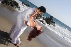 Young Couple at the beach dancing Stock Photo