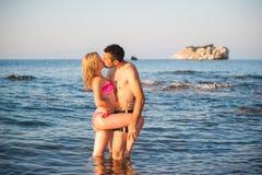 Young Couple at Beach Stock Photos