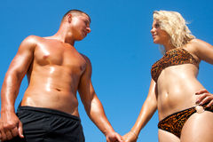 Young couple in the beach Stock Image