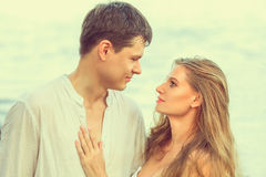 Young couple at beach stock photos
