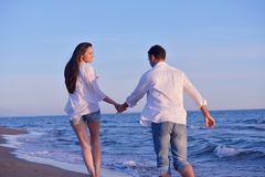 Young couple  on beach have fun Stock Image