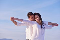 Young couple  on beach have fun Stock Images