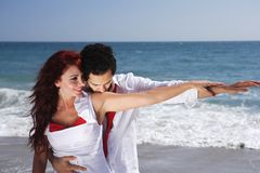 Young Couple at the beach holding hands Royalty Free Stock Images