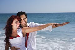 Young Couple at the beach holding hands Stock Photo