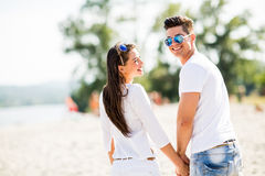 Young couple on the beach Stock Photography