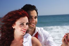 Young Couple at the beach holding hands close up Stock Images