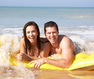 Young couple on beach holiday. In the sun royalty free stock images