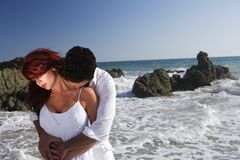 Young Couple at the beach kissing Royalty Free Stock Photos