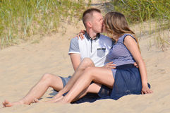 Young couple at beach kissing Royalty Free Stock Images