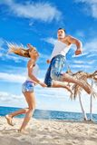 Young couple on the beach. Young loving couple on the summer beach Royalty Free Stock Photography