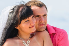 Young couple on a beach Royalty Free Stock Photos