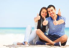 Young couple on the beach Stock Images