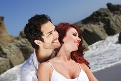 Young Couple at the beach showing affection Stock Image