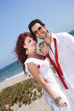 Young couple at the beach smiling and posing Royalty Free Stock Photography