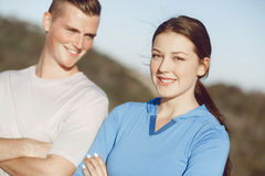 Young couple on beach in sportwear Stock Image
