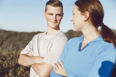 Young couple on beach in sportwear Royalty Free Stock Image
