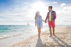 Young Couple On Beach Summer Vacation, Happy Smiling Man And Woman Walking Seaside Royalty Free Stock Image