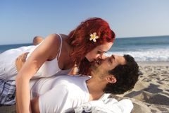 Young couple at the beach about to kiss Stock Photo