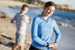 Young couple on beach training together Royalty Free Stock Image
