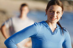 Young couple on beach training together Royalty Free Stock Photo