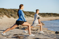 Young couple on beach training together Stock Images