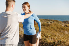Young couple on beach training together Stock Photo
