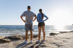 Young couple on beach training together Stock Photos