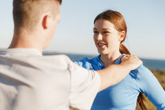 Young couple on beach training together Royalty Free Stock Images