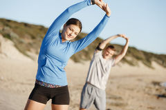 Young couple on beach training together Royalty Free Stock Photos