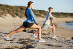 Young couple on beach training together Stock Image