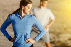 Young couple on beach training together Royalty Free Stock Photography